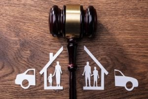 Gavel separating a home, family and car to depict divorce and child custody lawyer.